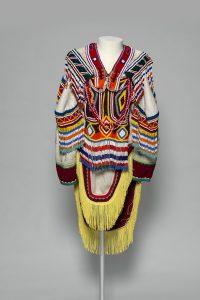 Unidentified artist.ˇAmautik, c. 1995.ˇwool duffle, glass beads, nylon fringe, cotton ribbon, cotton thread, and felt,ˇ150 x 90 cm.ˇCollection of the Winnipeg Art Gallery